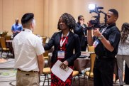 Riesa interviewing attendees of the ADEA Annual Conference